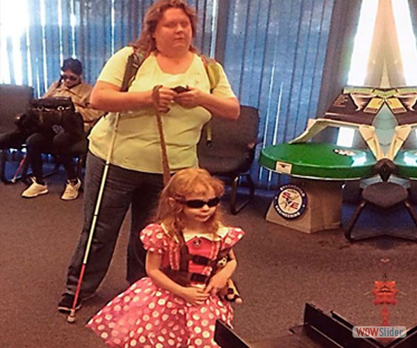A blind parent and her daughter are coming to the children's department at BSS.
