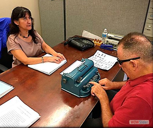 Christine Davidson is teaching Sal how to type Braille.