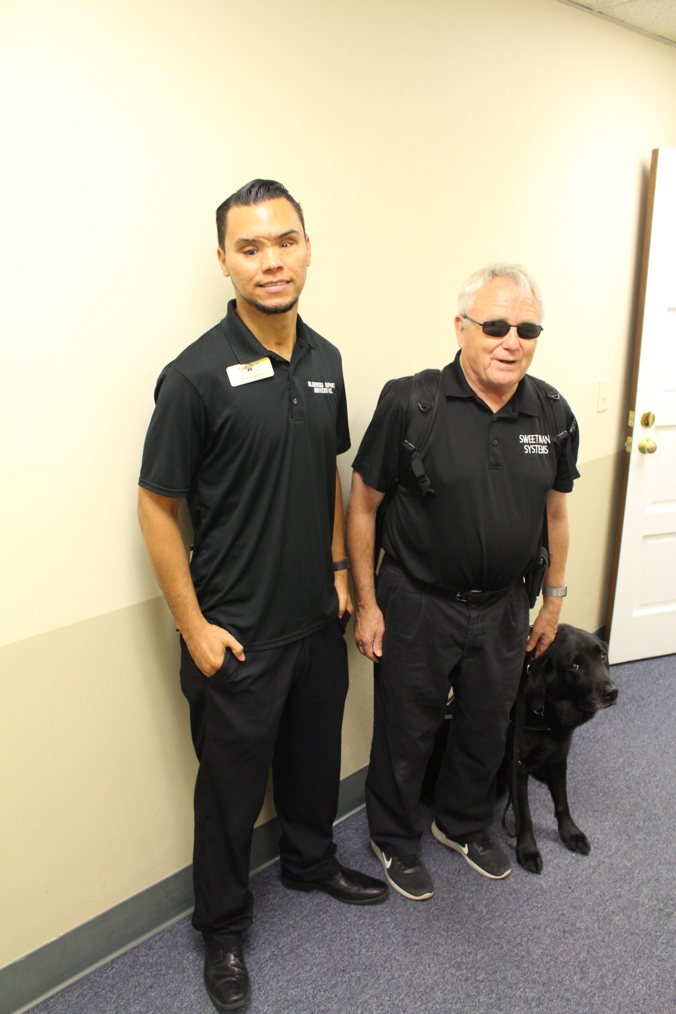 Feliciano, Assistive technology specialist, and Bob Sweetman standing side by side