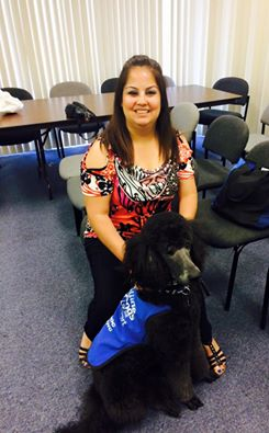 Priscilla with a black guide dog
