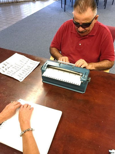 Salvador Novella is learning Braille