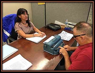 Sal learning to type Braille at BSS with his Braille instructor