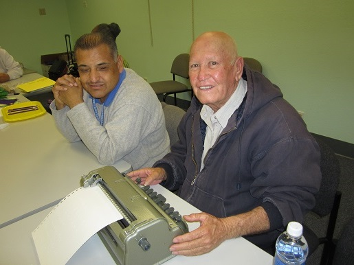 Ramiro is learning how to type Braille with Ciro Trulillo.