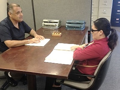 Braille Instructor Ciro Trujillo and his student Octavia learning Braille