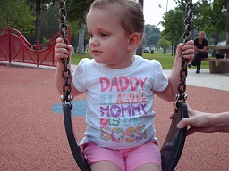A blind child playing on a swing at park day