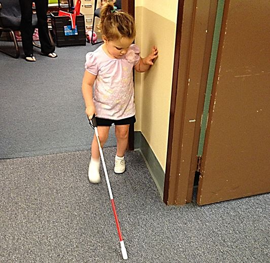 A blind pre schooler learning to navigate with a white cane