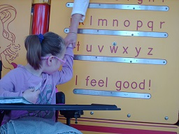 A child reading the Braille wall at Fairmount park
