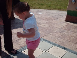 A child playing on the musical steps at the sensory playground at Fairmount park