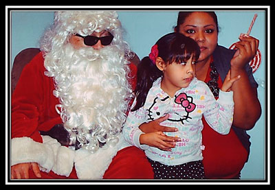 Santa posing with a Mother and Daughter