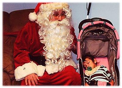 Blind Santa with a sleeping baby