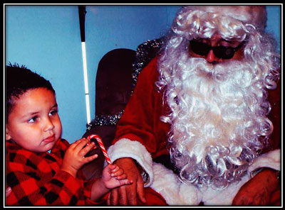Blind Santa and a blind child