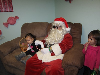 Santa posing with two children