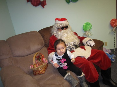 Santa posing with a small child