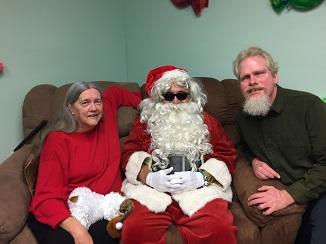 Lula, Santa and Kelly sitting on a couch