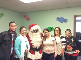 BSS staff posing with blind Santa