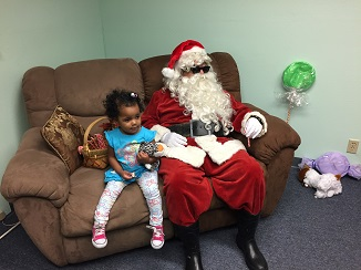 Blind Santa posing with a little girl