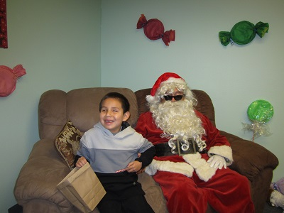 A child sitting with Santa