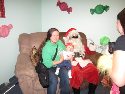 A Mother and her baby posing with Santa