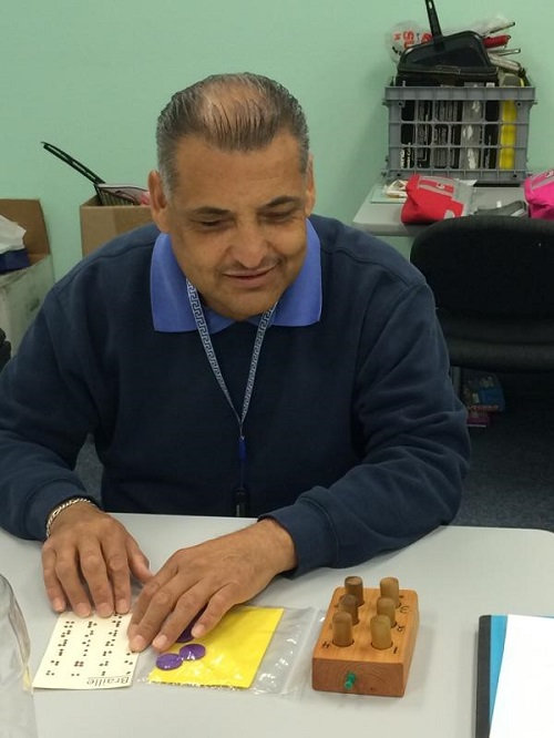Ciro playing Loteria using Braille