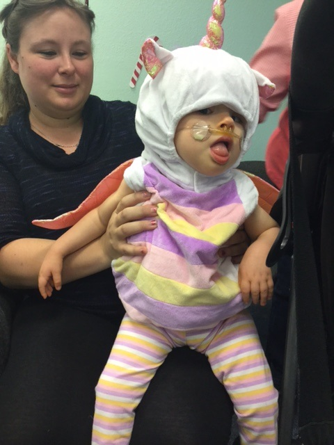 A child dressed as a unicorn.