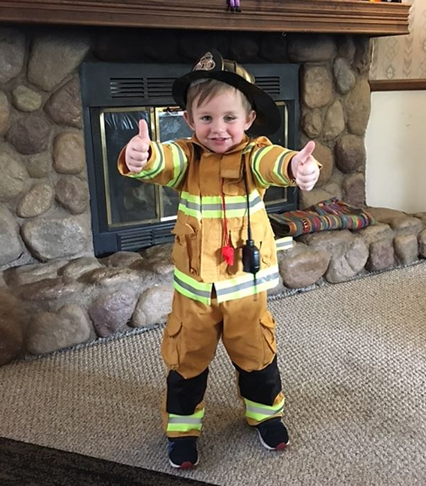 A little fireman with his thumbs in the air, everything is okay
