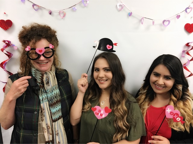 nancy waldner, dolores overa and nancy prieto holding up masks at the make-it take-it