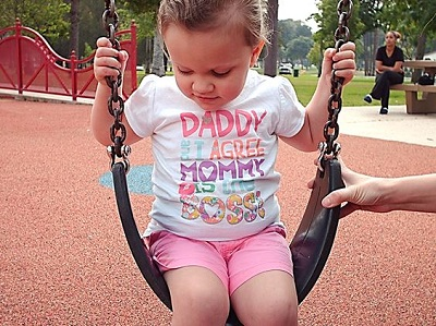 a child sitting on a swing