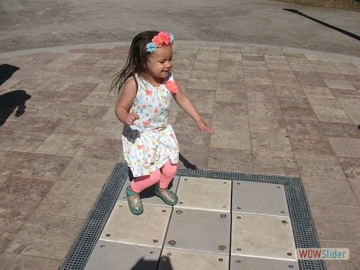 a girl is enjoying the sound sensory steps at the tactile playground