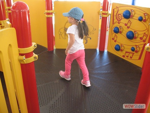 a child is in the playplace at the tactile playground