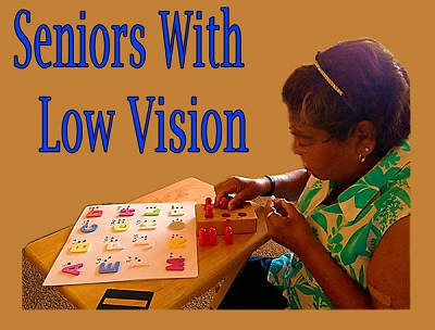 seniors with low vision learning with Braille teaching props.