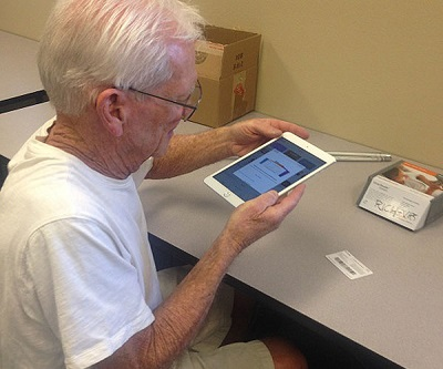 Richard is learning how to use his iPad in Assistive Technology