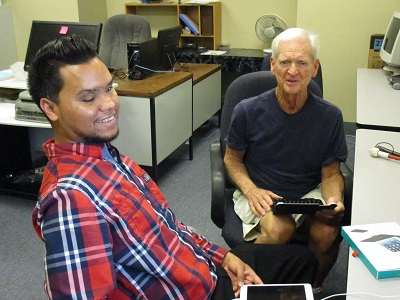 Feliciano Godoy and a student in the computer lab