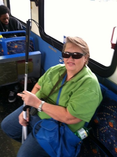 Teresa Mealer riding the bus as part of the travel Training at BSS