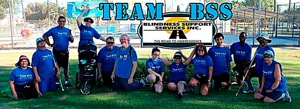 Team BSS members in a field with everyone wearing blue Team BSS shirts